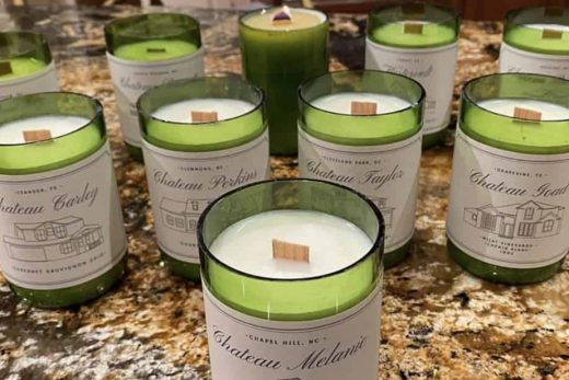 custom designed and named candles in wine bottles